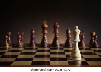 Lonely White Chess Queen Figure On Battleground. Chessboard With Dark  Background