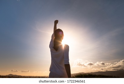 Never give up. Woman with fist up feeling strong, powerful and determined.