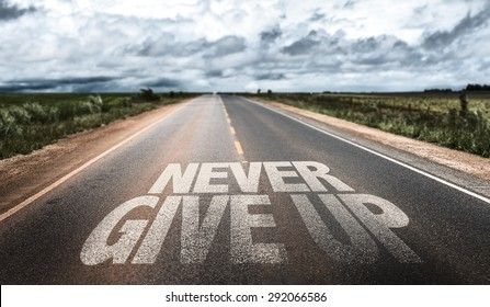 Never Give Up written on rural road