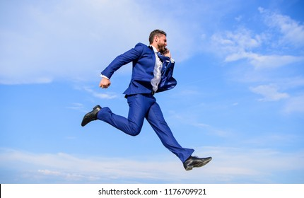 Never stop. Businessman formal suit jump while call smartphone sky background. Businessman solving business problems on phone. Entrepreneur in motion success expression. Keep going towards your goal.