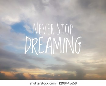 NEVER STOP DREAMING Quote on blurry sky background. concept of freedom, dreams, ambition and motivation.