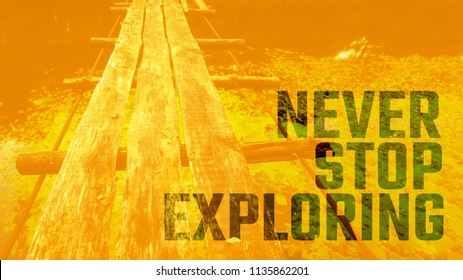 never stop exploring slogan on image with ruined wooden rope bridge in forest, free font is used