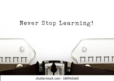 Never Stop Learning printed on an old typewriter.