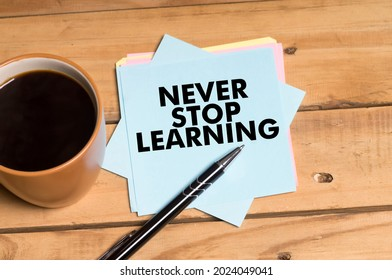 Never Stop Learning words written on notepad