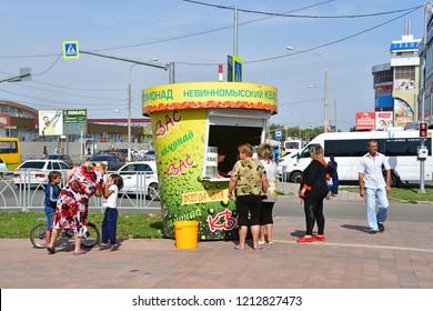 "Nevinnomyssk, Russia, September, 14, 2018. People in front of the pavilion "" Nevinnomyssky kvass"""