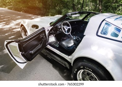 NEVINOMYSSC, RUSSIA - MAY 13, 2016: Automobiles. Offsite photography of old American cars. Chevrolet Corvette C3 1978g. View of the machine on the side with the door open and the roof removed on a
