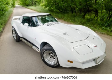 NEVINOMYSSC, RUSSIA - MAY 13, 2016: Automobiles. Offsite photography of old American cars. Chevrolet Corvette C3 1978. Machine type from the front on a country road in a forest