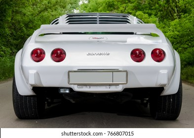 NEVINOMYSSC, RUSSIA - MAY 13, 2016: Automobiles. Offsite photography of old American cars. Chevrolet Corvette C3 1978. Rear view of machine on a country road in a forest