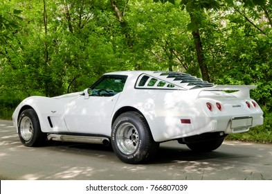 NEVINOMYSSC, RUSSIA - MAY 13, 2016: Automobiles. Offsite photography of old American cars. Chevrolet Corvette C3 1978. Machine type on the side on a country road in a forest