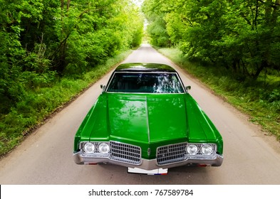 NEVINOMYSSC, RUSSIA - MAY 13, 2016: Automobiles. Offsite photography of old American cars. Oldsmobile 98. Machine type from the front on a country road in a forest