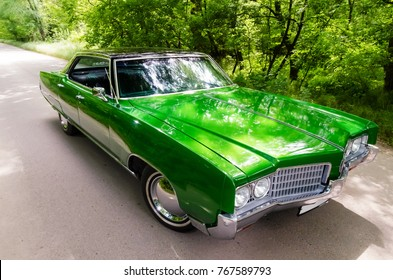 NEVINOMYSSC, RUSSIA - MAY 13, 2016: Automobiles. Offsite photography of old American cars. Oldsmobile 98. Machine type on the side on a country road in a forest