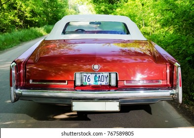 NEVINOMYSSC, RUSSIA - MAY 13, 2016: Automobiles. Offsite photography of old American cars. Cadillac Eldorado Convertible 1976. Rear view of machine on a country road in a forest
