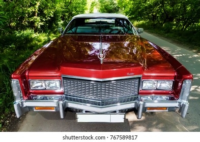 NEVINOMYSSC, RUSSIA - MAY 13, 2016: Automobiles. Offsite photography of old American cars. Cadillac Eldorado Convertible 1976. Machine type from the front on a country road in a forest