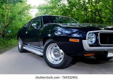 NEVINOMYSSC, RUSSIA - MAY 13, 2016: Automobiles. Offsite photography of old American cars. MC AMX Javelin 1972s. Machine type from the front on a country road in a forest