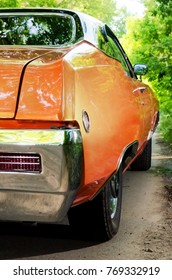 NEVINOMYSSC, RUSSIA - MAY 13, 2016: Automobiles. Offsite photography of old American cars. BUICK SKYLARK GS 350 1968s. Rear view of machine on a country road in a forest
