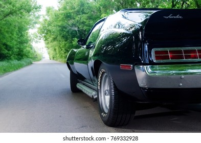 NEVINOMYSSC, RUSSIA - MAY 13, 2016: Automobiles. Offsite photography of old American cars. MC AMX Javelin 1972s. Rear view of machine on a country road in a forest