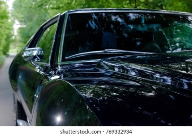 NEVINOMYSSC, RUSSIA - MAY 13, 2016: Automobiles. Offsite photography of old American cars. MC AMX Javelin 1972s. Machine type on the side on a country road in a forest