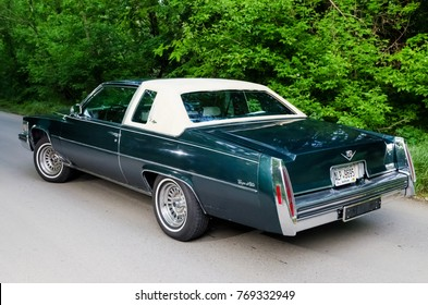 NEVINOMYSSC, RUSSIA - MAY 13, 2016: Automobiles. Offsite photography of old American cars. Cadillac DeVille D'Elegance 1978s. Rear view of machine on a country road in a forest
