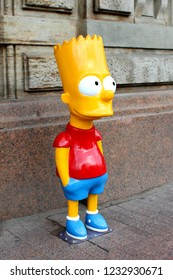 Nevsky Prospect, St. Petersburg, Russia - August 2018, Statue of Bart Simpson in the street near the wall