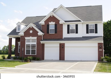New 2 story brick home with 3 car garage