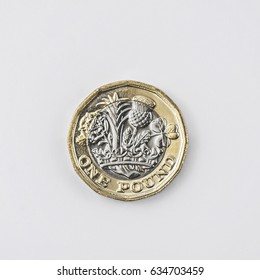 New 2017 UK one pound coin shot from above in studio on a white background.