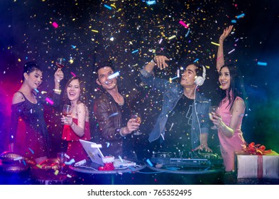 New 2018 Year is coming! Group of cheerful young asian people in dance party cand throwing a small pieces of colored paper.