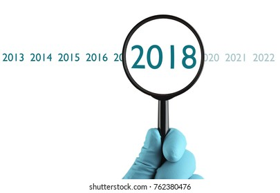 New 2018 year under magnification. Organization process, analytics, research, planning, report, market analysis. Isolated on white background.
