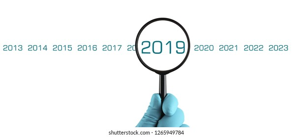 New 2019 year under magnification. Organization process, analytics, research, planning, report, market analysis. Isolated on white background.