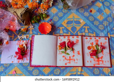 New accounts books opened to start writing in new year, are being worshipped on auspicious day of Bengali new year, called nabobarsho. Holy hibiscus flower, swastika sign on the pages as per ritual.