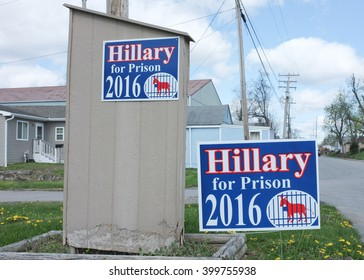 "New Albany, IN - April 2, 2016: Political signs reading ""Hillary for Prison"" show disapproval of Democratic presidential candidate Hillary Clinton. Southern Indiana has a conservative electorate."