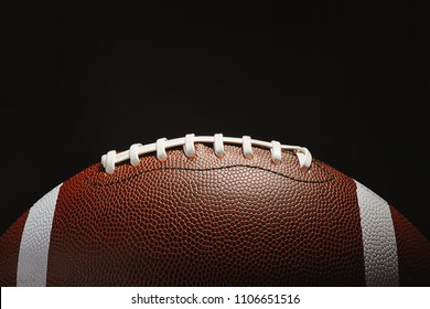 New American football ball on dark background