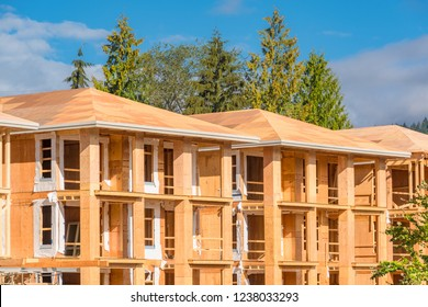 New apartment building under construction on blue sky background