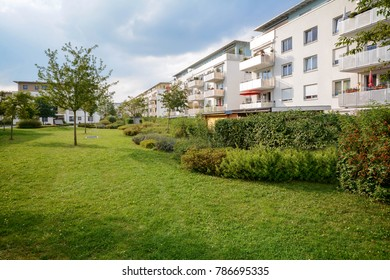 New apartment buildings, modern residential development with outdoor facilities in a green urban settlement