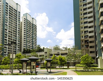A new apartment neighborhood with carpark and playground.