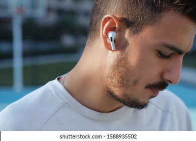 New Apple Airpods Pro outdoor images, showing with a person on-ear. 03.12.2019 Bornova, Izmir, Turkey