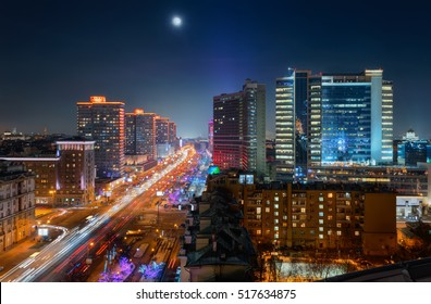 New Arbat Street, highway with moving cars at moony night in Moscow, Russia