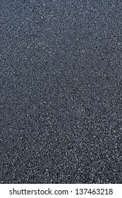 New asphalt abstract background close up.