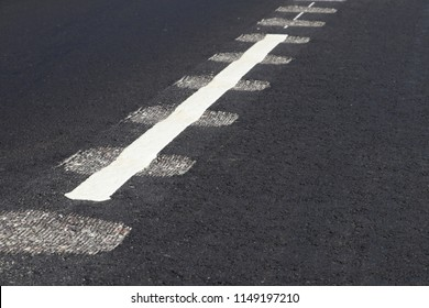 New asphalt road. Closeup view of rumble strips on a road