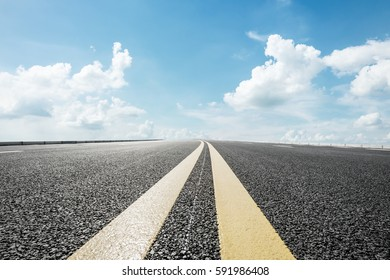 New asphalt road under the blue sky