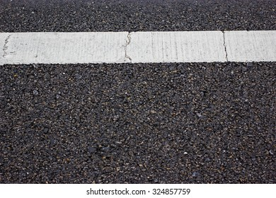 New asphalt texture and white dashed line.