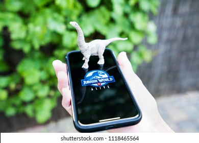 The new augmented reality app: Jurassic World alive. Based on the famous movies. Sort of like the hype Pokemon Go. Spijkenisse, The Netherlands 21-06-2018.