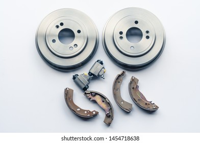 New auto parts brake drums, pads, cylinders on white background