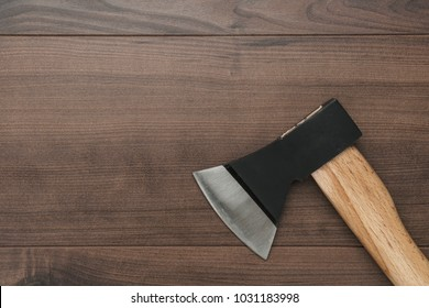 new axe on the wooden table background