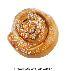 New baked cinnamon bun with pearl sugar on top photographed from above