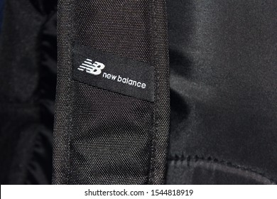 New Balance brand tag in Moscow on October 2019. NB (New Balance) sporting brand logo on black bag