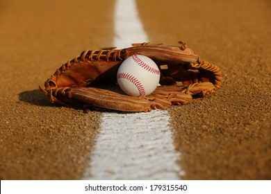 New Baseball in a Glove in the Infield