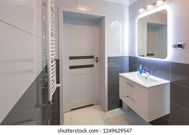 New bathroom interior with illuminated mirror