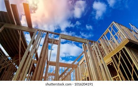 New beam construction home framing over blue sky