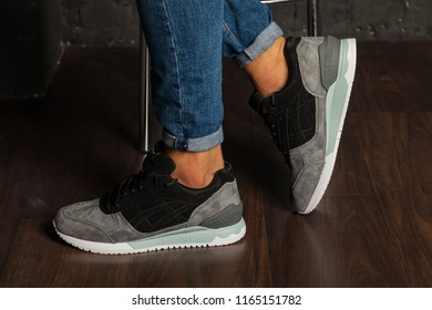 New beautiful colorful and nice Asics Gel running shoes, sneakers, trainers shows the logo with a brand box on abstract background. Sport and casual footwear concept. Kyiv, Ukraine-August 26, 2018 - Shutterstock ID 1165151782
