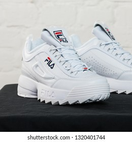 New beautiful colorful and nice Fila Disruptor running shoes, sneakers, trainers shows logo with a brand box on abstract background. Sport and casual footwear concept. Kyiv, Ukraine-January 28, 2018